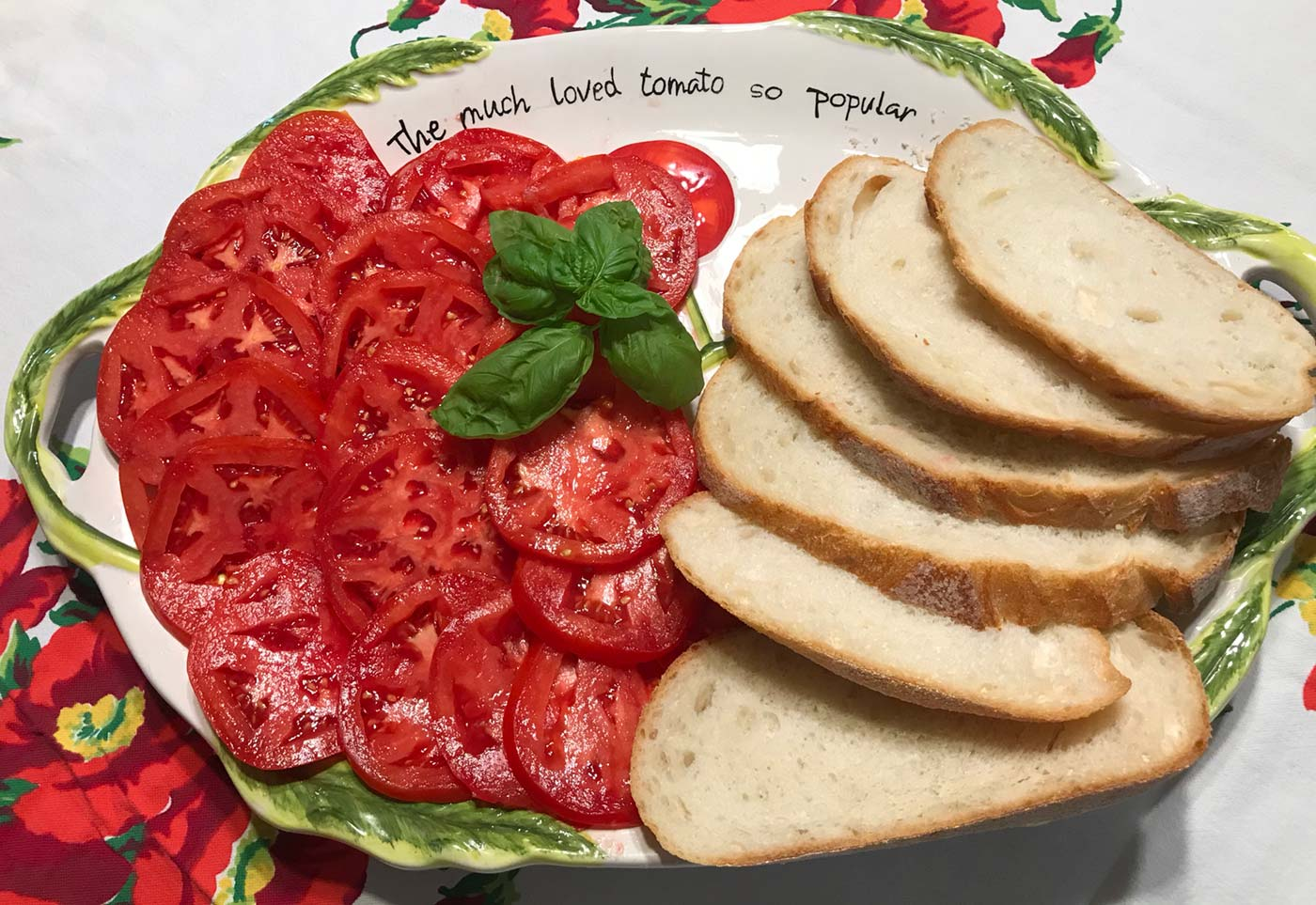 Jersey tomatoes arranged on a plate with bread