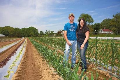 Barry and Carol Savoie on their organic farm