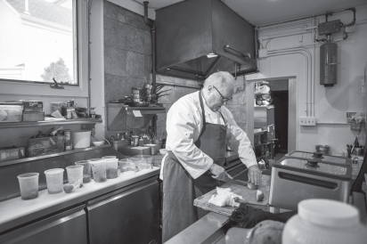 Dennis Foy in kitchen