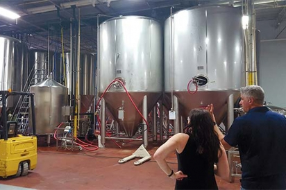 Tara on a tour of Funky Buddha Brewing