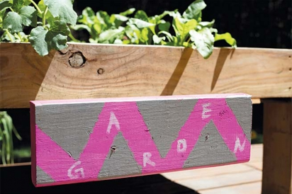 Lyla and Emily's hand painted garden sign