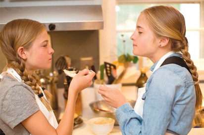 The Kitchen Twins hard at work taste-testing