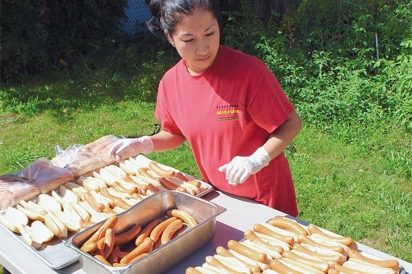 freshly grilled hot dogs from Union Pork Store, ready for tour goers