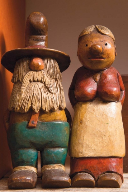 Atop handmade kitchen shelves crafted from reclaimed wood sit two '70s-era folklore figurines by Duke Snitch, purchased by Child's grandfather in the Pine Barrens.