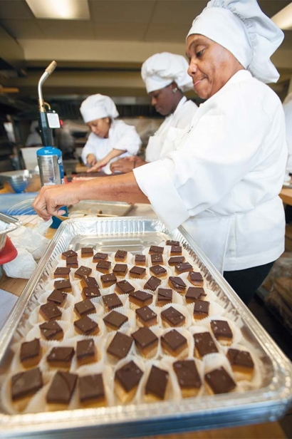 Students prepare bite-sized sweets