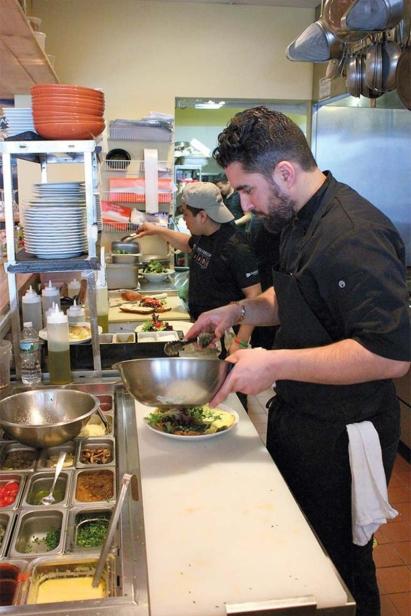 Chef Meny Vankin plating a salad