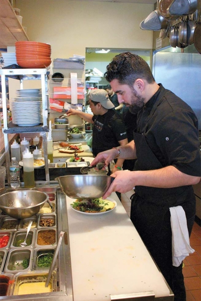 Chef Meny Vankin plating a salad