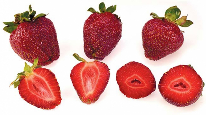 whole and sliced strawberries